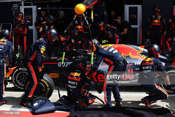 Pierre Gasly of France driving the Aston Martin Red Bull Racing RB15 makes a pit stop for new tyres during the F1 Grand Prix of Great Britain at...