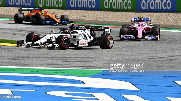 Pierre Gasly of France driving the Scuderia AlphaTauri AT01 Honda leads Lance Stroll of Canada driving the Racing Point RP20 Mercedes and Lando...