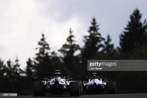 Pierre Gasly of France driving the Scuderia AlphaTauri AT01 Honda chases Nicholas Latifi of Canada driving the Williams Racing FW43 Mercedes during...