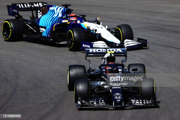 Pierre Gasly of France driving the Scuderia AlphaTauri AT02 Honda leads George Russell of Great Britain driving the Williams Racing FW43B Mercedes...
