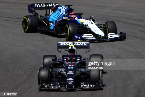 Pierre Gasly of France driving the Scuderia AlphaTauri AT02 Honda leads George Russell of Great Britain driving the Williams Racing FW43B Mercedes on...