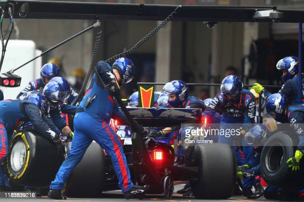 Pierre Gasly of France driving the Scuderia Toro Rosso STR14 Honda makes a pitstop for new tyres during the F1 Grand Prix of Mexico at Autodromo...