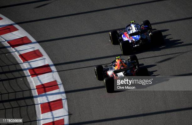 Pierre Gasly of France driving the Scuderia Toro Rosso STR14 Honda and Alexander Albon of Thailand driving the Aston Martin Red Bull Racing RB15 on...