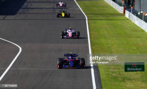 Pierre Gasly of France driving the Scuderia Toro Rosso STR14 Honda leads Lance Stroll of Canada driving the Racing Point RP19 Mercedes on track...