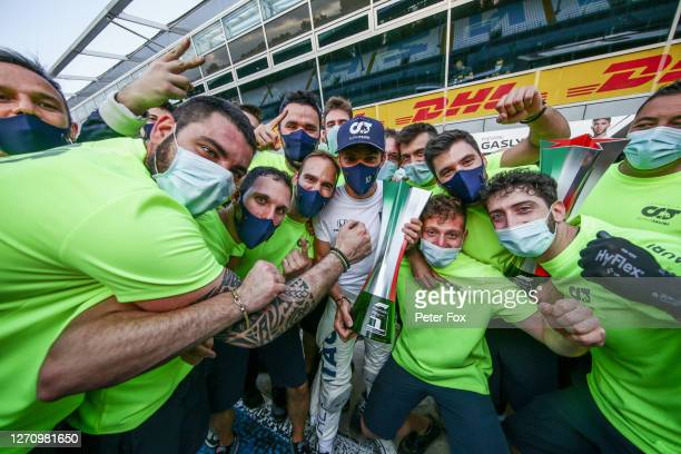 Pierre Gasly of Scuderia AlphaTauri and France celebrates with the team after winning the F1 Grand Prix of Italy at Autodromo di Monza on September...