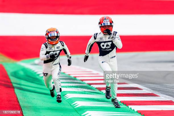 Pierre Gasly of Scuderia AlphaTauri and France with Yuki Tsunoda of Scuderia AlphaTauri and Japan during previews ahead of the F1 Grand Prix of...