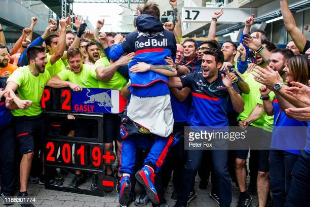 Pierre Gasly of Scuderia Toro Rosso and France celebrates with the team for finishing in 2nd position during the F1 Grand Prix of Brazil at Autodromo...