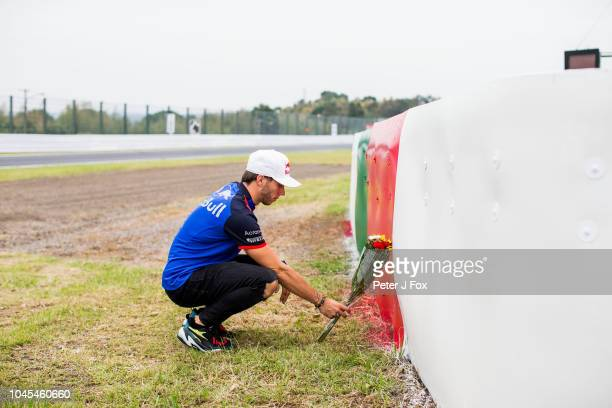 Pierre Gasly of Scuderia Toro Rosso and France lays a tribute to his childhood friend Jules Bianchi of France who was killed during the 2014 Japanese...