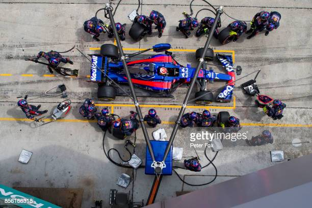 Pierre Gasly of Scuderia Toro Rosso and France Pit Stop during the Malaysia Formula One Grand Prix at Sepang Circuit on October 1 2017 in Kuala...