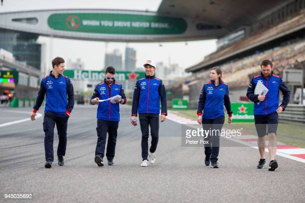 Pierre Gasly of Scuderia Toro Rosso and France walks the track with his engineers during previews ahead of the Formula One Grand Prix of China at...