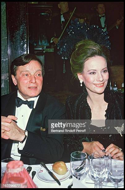 Pierre GaspardHuit and his wife Claudine Auger at a party at 'Maxim' s'