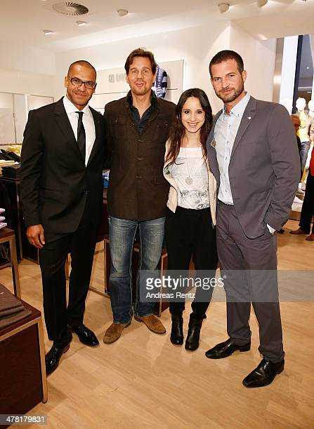 Pierre Geisensetter Thomas Heinze Stephanie Stumph and Simon Boeer attend the Pohland store opening on March 12 2014 in Dortmund Germany