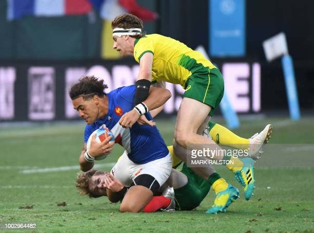 Pierre Gilles Lakafia of France is tackled by Ben O'Donnell of Australia during their men's round of 16 games at the Rugby Sevens World Cup in the...