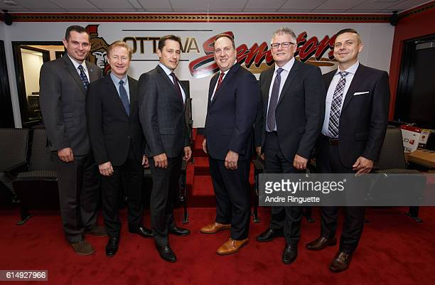 Pierre GroulxRob Cookson Guy Boucher Martin Raymond Marc Crawford and Kristopher Young of the Ottawa Senators pose for a photo before a game against...