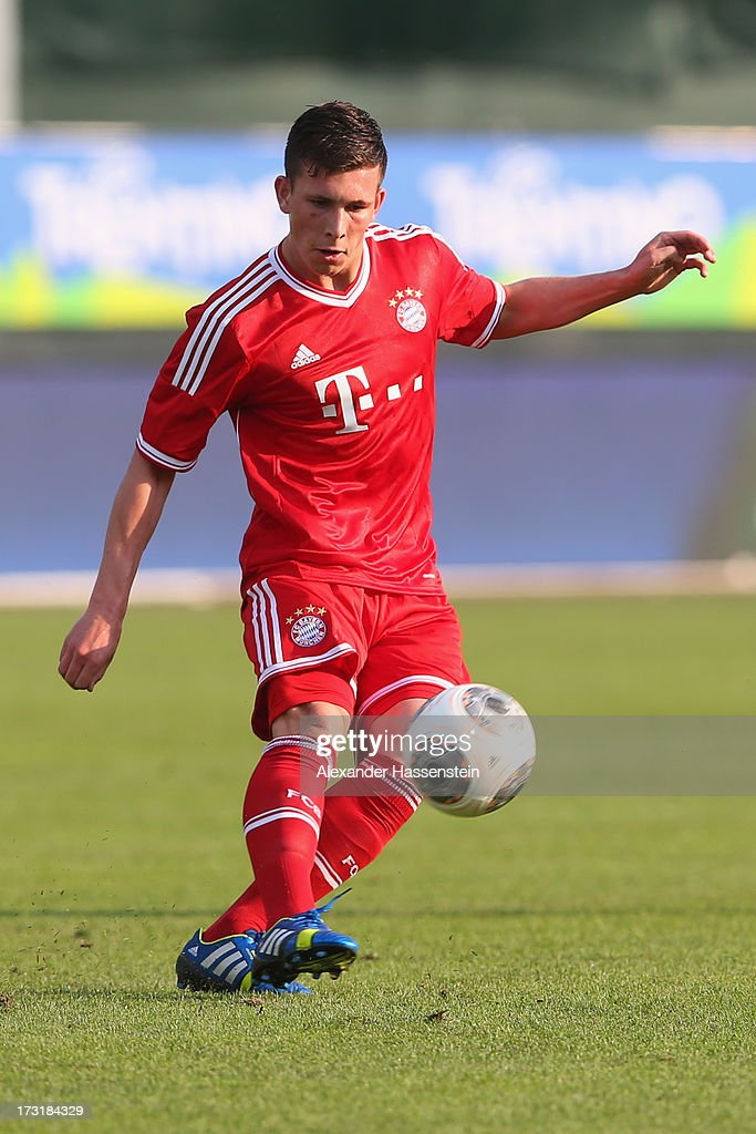 Pierre Hojbjerg of Bayern Muenchen runs with ball during the friendly match between Brescia Calcio and FC Bayern Muenchen at Campo Sportivo on July 9, 2013 in Arco, Italy.
