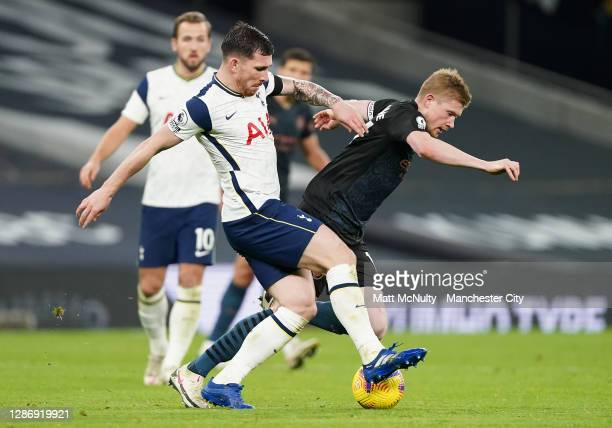 Pierre Hojbjerg of Tottenham Hotspur tackles Kevin de Bruyne of Manchester City during the Premier League match between Tottenham Hotspur and...