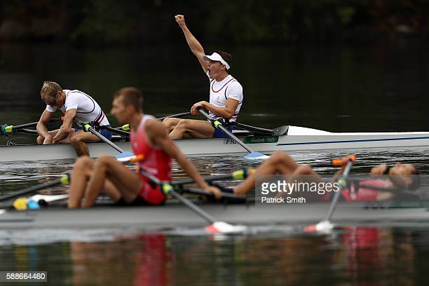 Pierre Houin and Jeremie Azou of France celebrate winning the gold medal after the Lightweight Men's Double Sculls Final A on Day 7 of the Rio 2016...