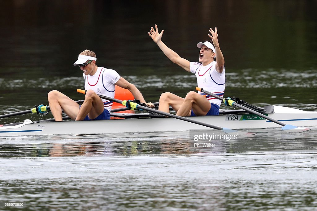 Pierre Houin (R) and Jeremie Azou (L) of France celebrate winning the gold medal after the Lightweight Men's Double Sculls Final A on Day 7 of the Rio 2016 Olympic Games at Lagoa Stadium on August 12, 2016 in Rio de Janeiro, Brazil.