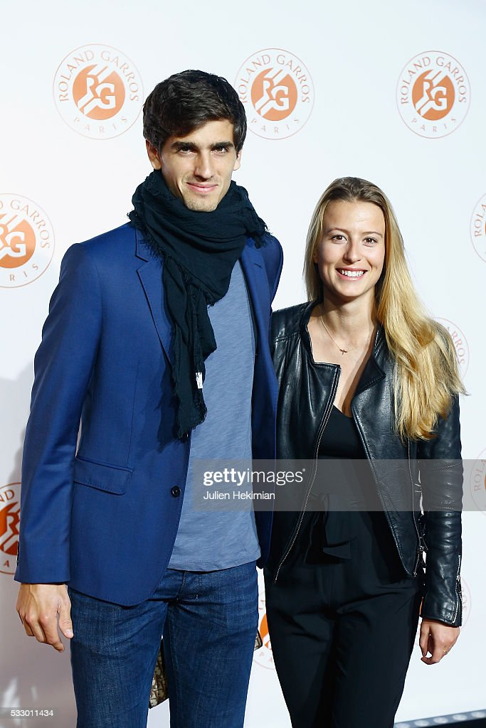 Pierre Hugues Herbert of France and his girlfriend attend the Roland Garros Players' Party at Grand Palais on May 19, 2016 in Paris, France.