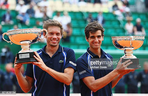 Pierre Hugues Herbert of France and Nicolas Mahut of France pose with their trophies after victory in the doubles final match against Jamie Murray of...