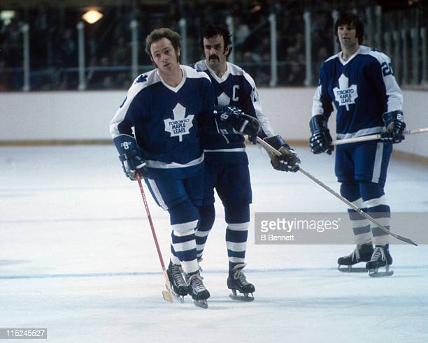 Pierre Jarry Dave Keon and Garry Monahan of the Toronto Maple Leafs skate on the ice during an NHL game circa 1972