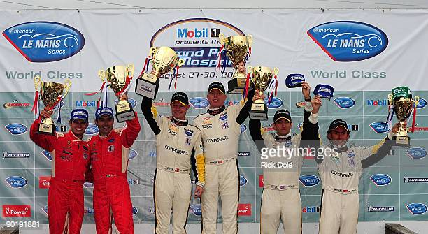 Pierre Kaffer Jamie Melo drivers of the Risi Competizione Ferrari 430 GT class winners Jan Magnussen and Johnny O'Connell drivers of the Corvette...