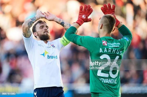 Pierre Kanstrup and Goalkeeper Aleksandar Jovanovic of AGF Aarhus celebrate after the Danish Superliga match between FC Midtjylland and AGF Aarhus at...
