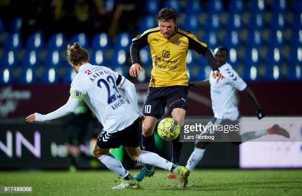 Pierre Kanstrup of AGF Aarhus and Pal Alexander Kirkevold of Hobro IK compete for the ball during the Danish Alka Superliga match between Hobro IK...