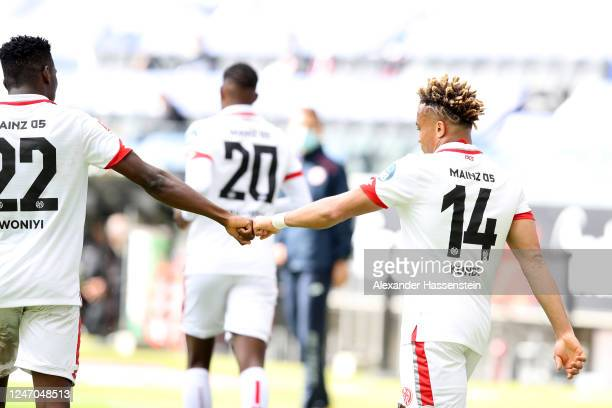 Pierre Kunde Malong of 1. FSV Mainz 05 celebrates with Taiwo Awoniyi after scoring his team's second goal during the Bundesliga match between...