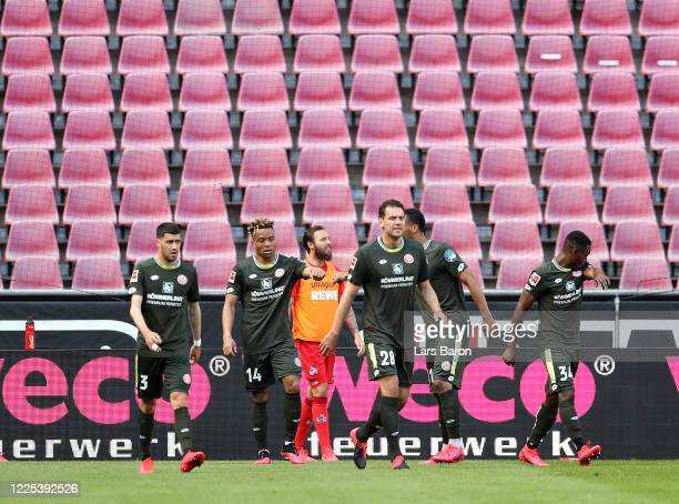 Pierre Kunde Malong of FSV Mainz 05 celebrates with teammates after scoring his team's second goal during the Bundesliga match between 1 FC Koeln and...