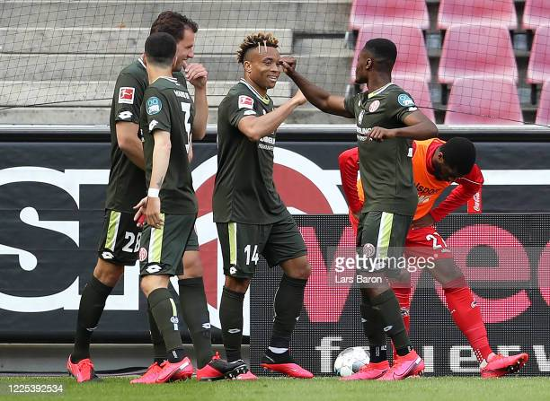 Pierre Kunde Malong of FSV Mainz 05 celebrates with teammates after scoring his team's second goal during the Bundesliga match between 1. FC Koeln...