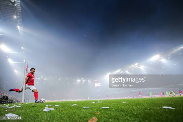 Pierre Kunde Malong of Mainz takes a corner kick during the Bundesliga match between 1 FSV Mainz 05 and Hannover 96 at Opel Arena on December 9 2018...