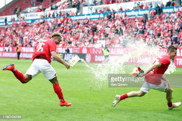 Pierre Kunde Malong pours beer over Gaetan Bussmann after the Bundesliga match between 1. FSV Mainz 05 and TSG 1899 Hoffenheim at Opel Arena on May...