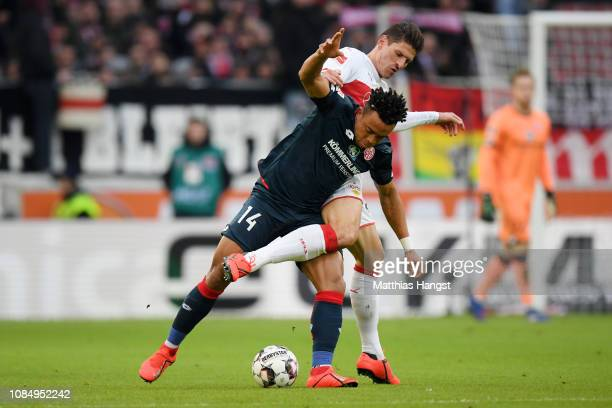 Pierre Kunde of FSV Mainz is challenged by Mario Gomez of VfB Stuttgart during the Bundesliga match between VfB Stuttgart and 1 FSV Mainz 05 at...