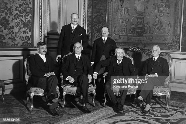 Pierre Laval a gauche president du Conseil et son ministre des Affaires etrangeres Aristide Briand second a droite assistent a une conference...