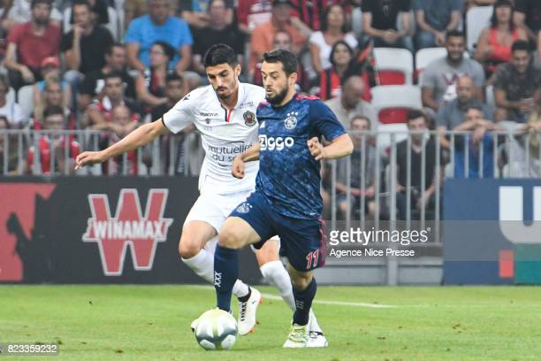 Pierre Lees Melou of Nice and Amin Younes of Ajax during the UEFA Champions League Qualifying match between Nice and Ajax Amsterdam at Allianz...