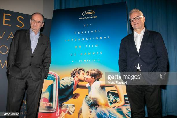 Pierre Lescure and Thierry Fremaux pose in front of the Cannes Film Festival official poster during the Cannes Film Festival Press Conference at...