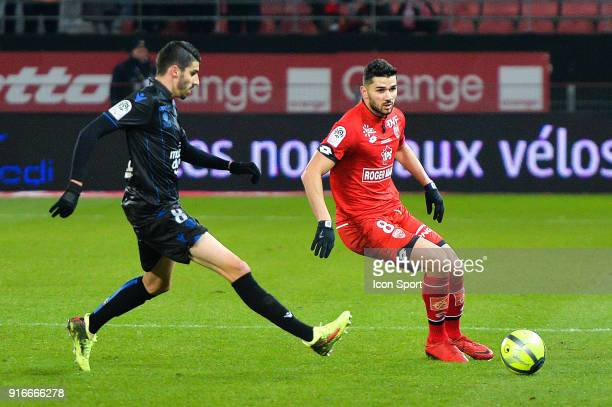 Pierre Less Melou of Nice and Mehdi Abeid of Dijon during the Ligue 1 match between Dijon FCO and OGC Nice at Stade Gaston Gerard on February 10 2018...