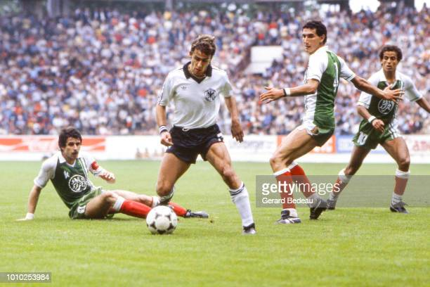 Pierre Littbarski of Germany FR Nordine Kourichi of Algeria during the World Cup match between Germany RF and Algeria at El Molinon Gijon Spain on...
