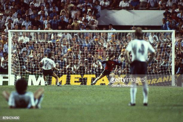 Pierre Littbarski of Germany score a penalty Jean Luc Ettori of France during of the game Semi Final World Cup match between West Germany and France...