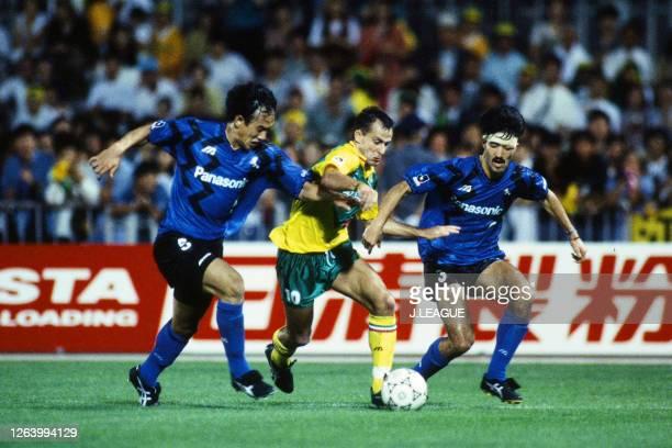 Pierre Littbarski of JEF United Ichihara competes for the ball against Hiroki Azuma and Naohiko Minobe of Gamba Osaka during the J.League Suntory...