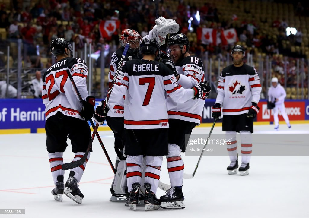 Pierre Luc Dubois of Canada celebrate with his team mates ...