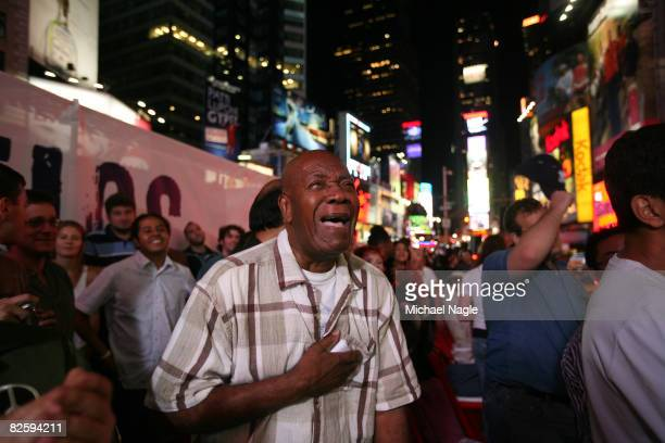 Pierre Mazarin of New York City tears up after watching in Time Square a projection of US Sen Barack Obama accepting the Democratic presidential...