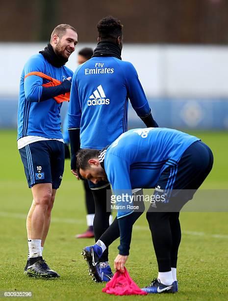 Pierre Michel Lasogga jokes with team mate Johan Djourou during a training session of Hamburger SV at Volksparkstadion on January 4 2017 in Hamburg...