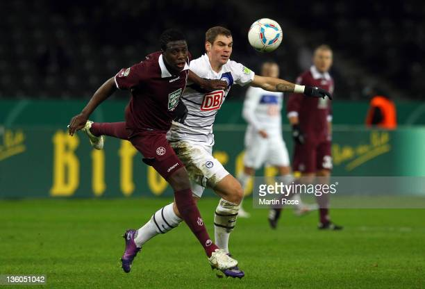 Pierre Michel Lasogga of Berlin and Rodnei of Kaiserslautern battle for the ball during the DFB Cup round of sixteen match between Hertha BSC Berlin...