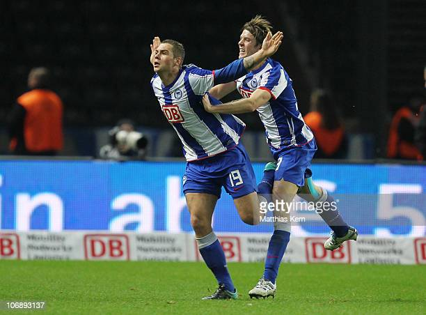 Pierre Michel Lasogga of Berlin jubilates with team mate Peter Niemeyer after scoring the second goal during the Second Bundesliga match between...