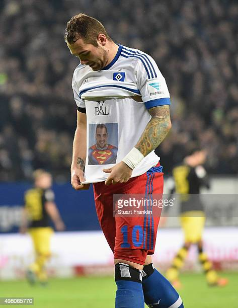 Pierre Michel Lasogga of Hamburg celebrates scoring the first goal as he wears a tee shirt with a picture of him as superman during the Bundesliga...