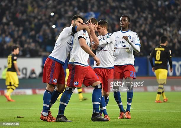 Pierre Michel Lasogga of Hamburg celebrates scoring the first goal during the Bundesliga match between Hamburger SV and Borussia Dortmund at...