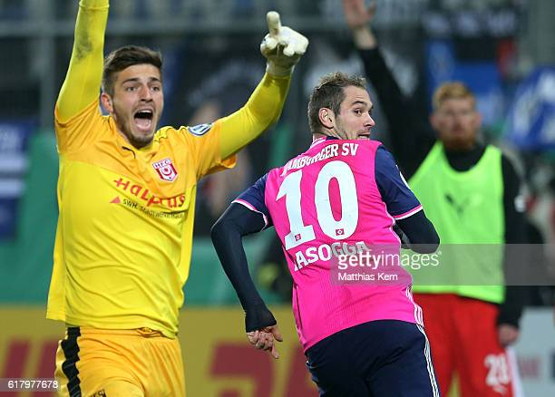 Pierre Michel Lasogga of Hamburg jubilates after scoring the third goal during the DFB Cup second round match between Hallescher FC and Hamburger SV...