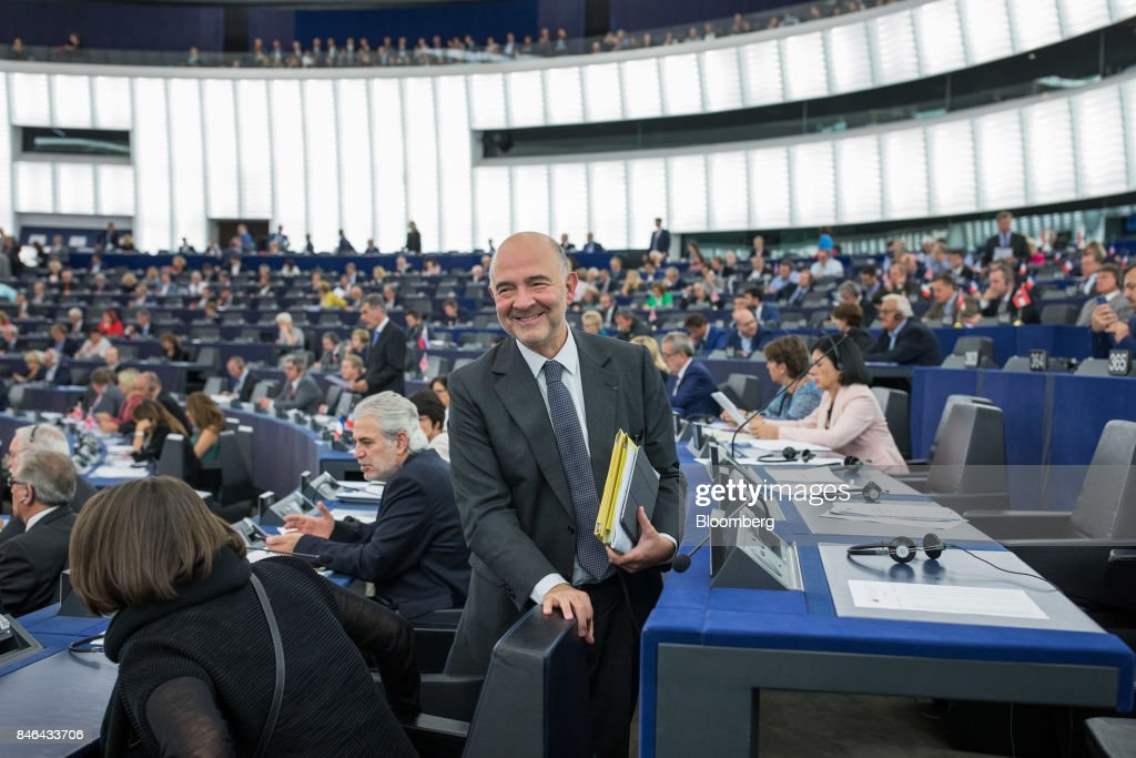 Pierre Moscovici, economic commissioner for the European Union (EU), leaves the State of the Union speech at the European Parliament in Strasbourg, France, on Wednesday, Sept. 13, 2017. In a sign of the EUs renewed confidence, European Commission President Jean-Claude Juncker will push for free-trade pacts withAustralia and New Zealandat a time when the U.S. is turning inward, along with a bloc-wide system for screening foreign takeovers and deeper euro-area banking integration. Photographer: Jasper Juinen/Bloomberg via Getty Images